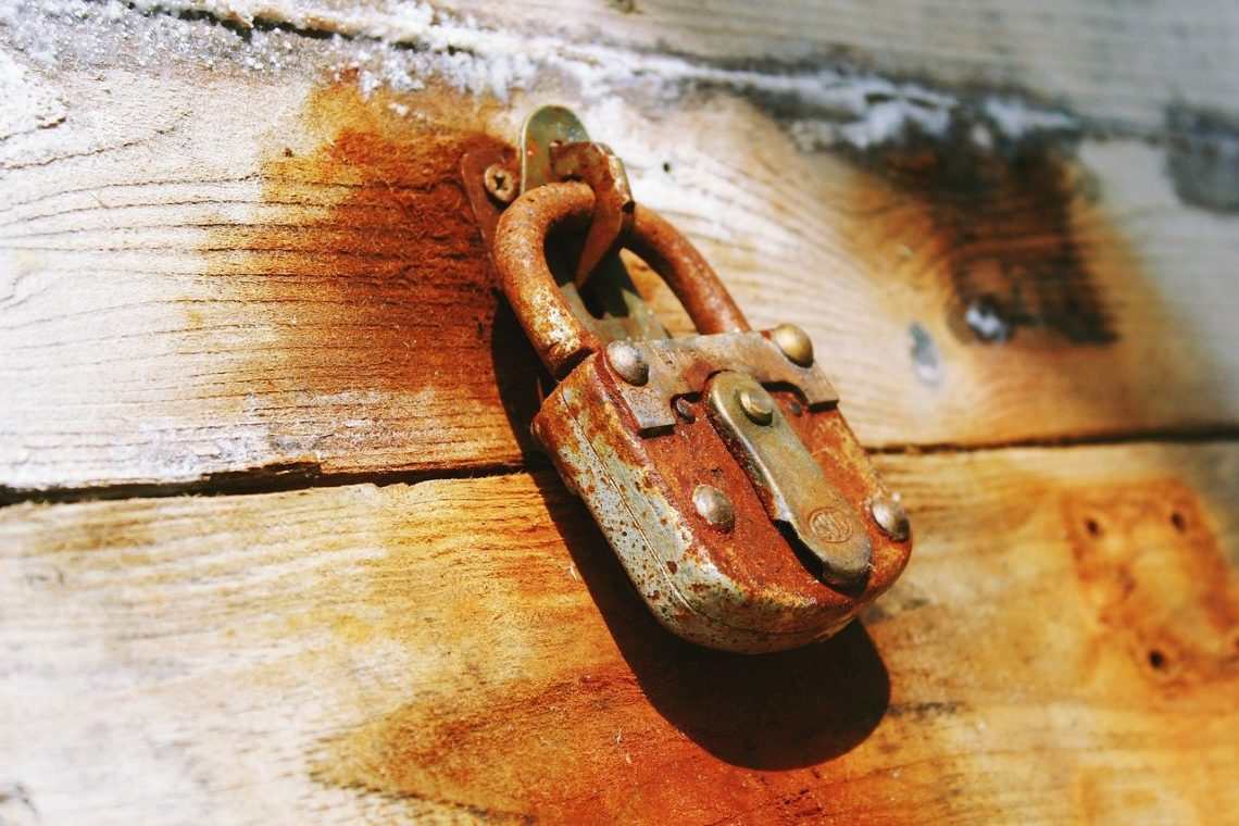 A picture of a rusted padlock as a metaphor for accessibility.